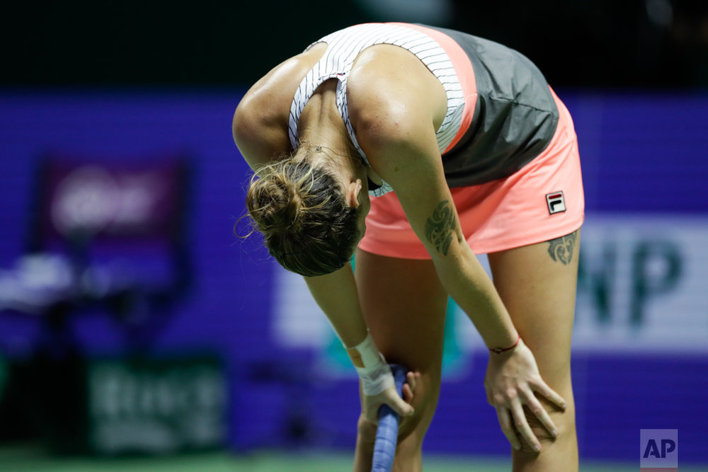 Karolina Pliskova of the Czech Republic reacts after conceding a point to Caroline Wozniacki of Denmark during her singles semifinal match at the WTA tennis tournament in Singapore, on Saturday, Oct. 28, 2017. (AP Photo/Yong Teck Lim)