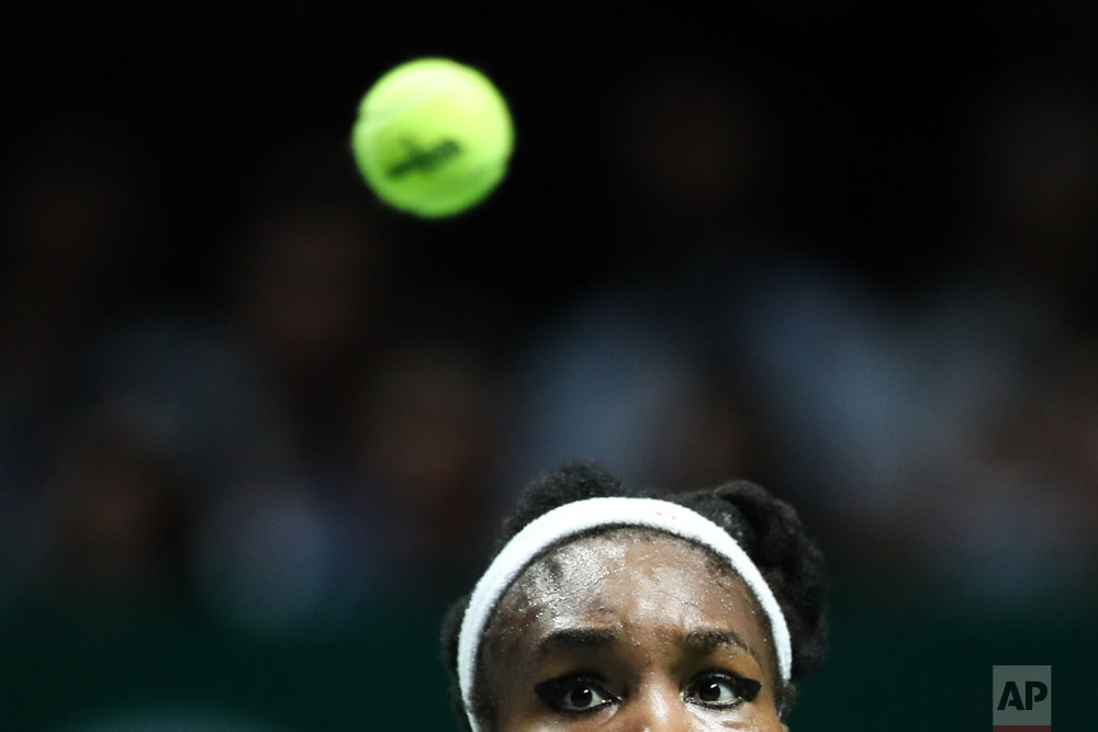 Venus Williams of the United States prepares to return the ball against Caroline Wozniacki of Denmark during their singles final match at the WTA tennis tournament in Singapore, on Sunday, Oct. 29, 2017. (AP Photo/Yong Teck Lim)