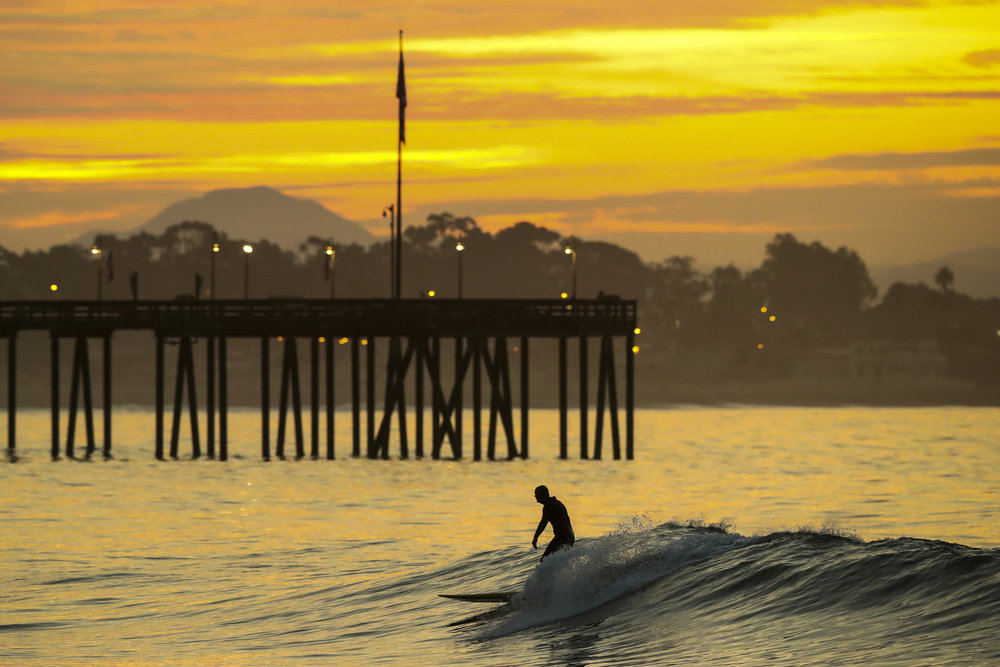 A man surfs at daybreak at Ventura Point on November 12, 2017 in Ventura, California.