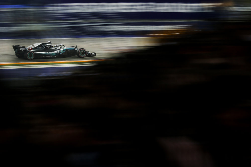 Mercedes driver Lewis Hamilton of Britain steers his car during the Singapore Formula One Grand Prix at the Marina Bay City Circuit in Singapore, Sunday, Sept. 16, 2018. (AP Photo/Yong Teck Lim)