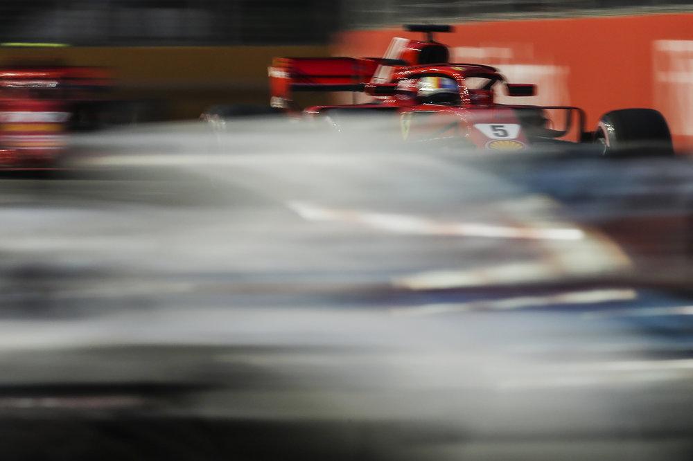 Ferrari driver Sebastian Vettel of Germany steers his car during third practice at the Marina Bay City Circuit ahead of the Singapore Formula One Grand Prix in Singapore, Saturday, Sept. 15, 2018. (AP Photo/Yong Teck Lim)
