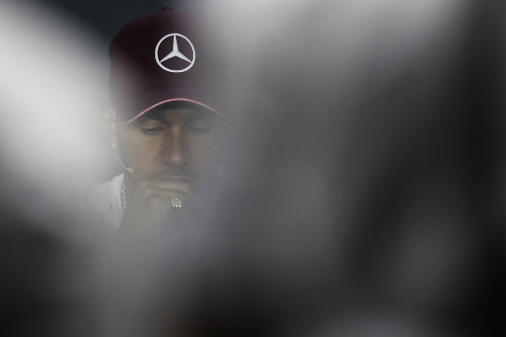 Mercedes driver Lewis Hamilton of Britain listens to questions during a press conference at the Marina Bay City Circuit ahead of the Singapore Formula One Grand Prix in Singapore, Thursday, Sept. 13, 2018. (AP Photo/Yong Teck Lim)