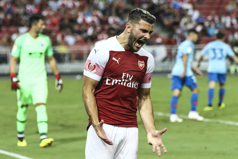 Arsenal's Sead Kolasinac reacts after missing a shot attempt during the International Champions Cup match between Arsenal and Atletico Madrid in Singapore, Thursday, July 26, 2018. (AP Photo/Yong Teck Lim)