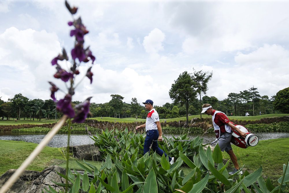 KUALA LUMPUR, MALAYSIA - OCTOBER 13: Gary Woodland of the United States walks up the 11th green during round three of the CIMB Classic at TPC Kuala Lumpur on October 13, 2018 in Kuala Lumpur, Malaysia. (Photo by Yong Teck Lim/Getty Images)