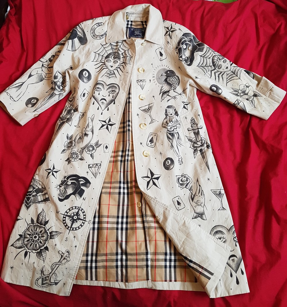 Custom vintage Burberry trench coat with traditional sailor jerry tattoo design, by Kate Lomax Art