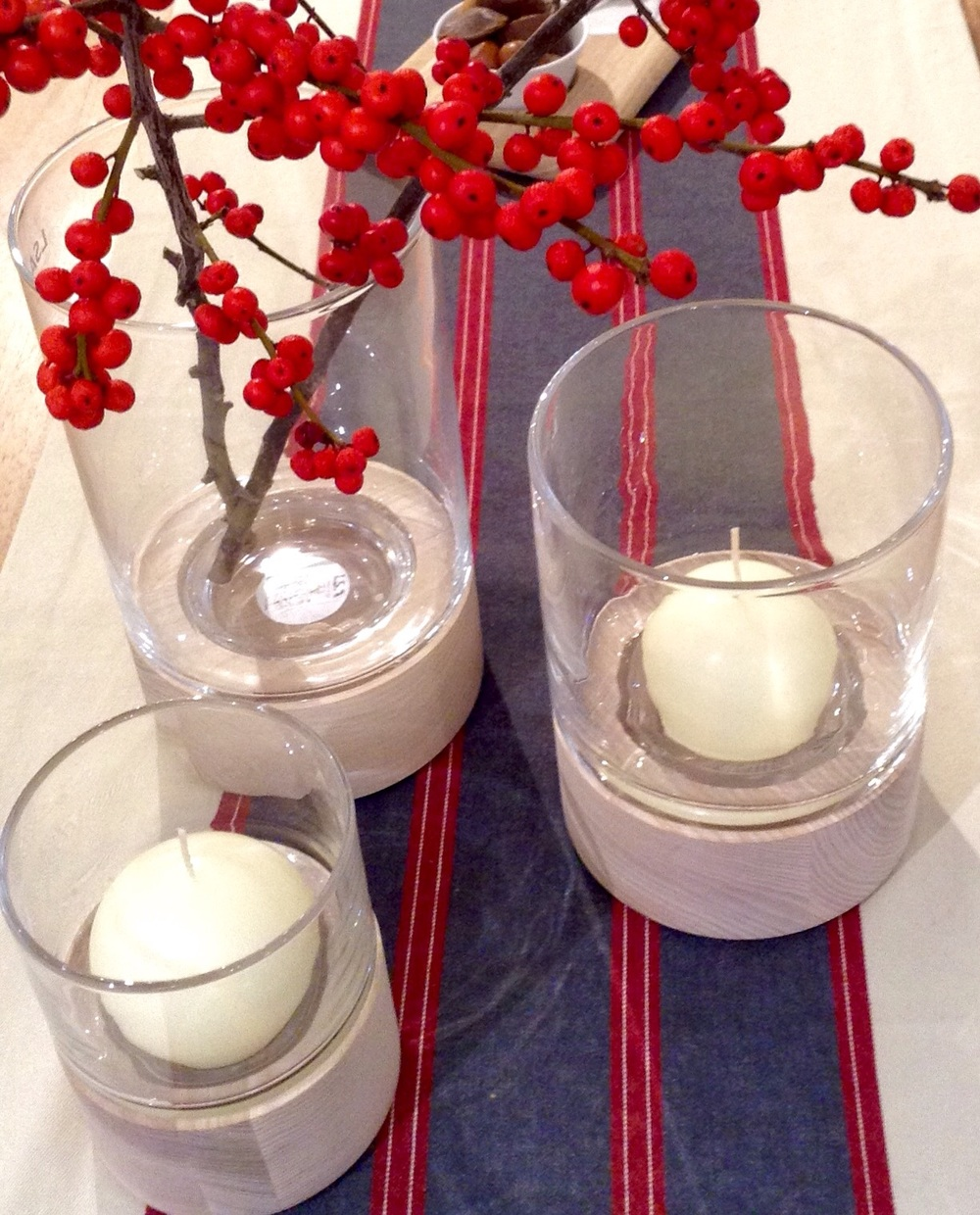 British made ash & hand blown glass, to be used for candles or flowers (we have used ilex berries for a seasonal feel) S £26.00, M £36.00, L £40.00