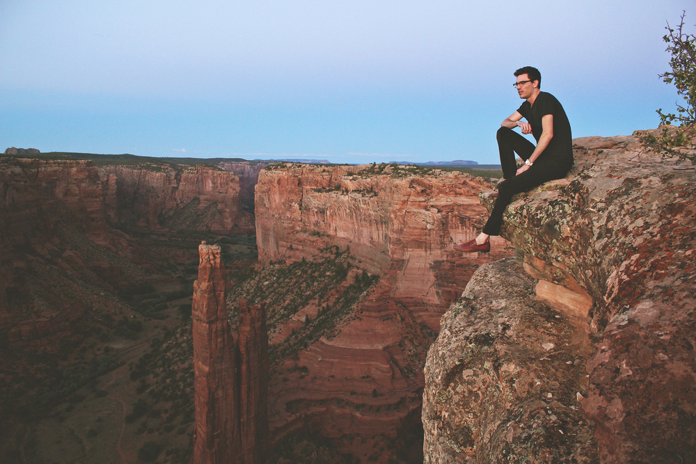 Preparing for flight on the edge of an 800 foot cliff. Spider Rock at Canyon De Chelly, Arizona.