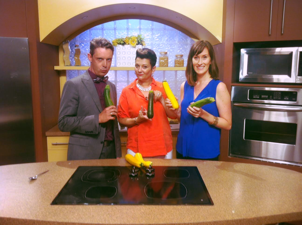 Daytime Ottawa hosts, Derick and Julie, and I showing off a colourful array of zucchinis from Roots Down Organic Farm.