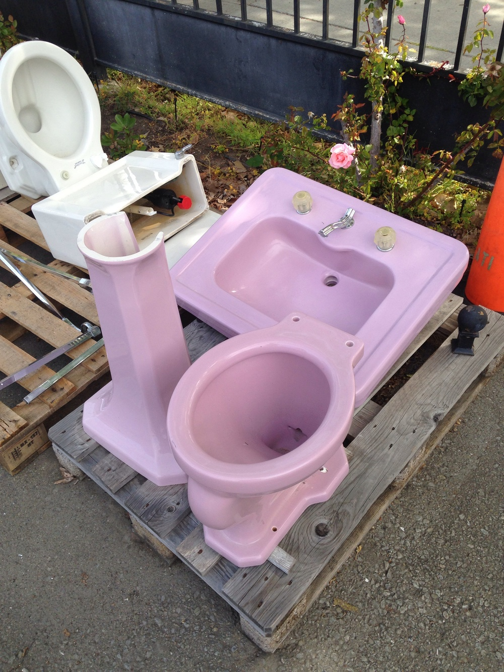 Lavender bath set circa '28-30s. '28 is the first year for color and wall tank toilets were phased out sometime in the 30s I would guess. The toilet would have a brass tube that comes out the back and curves up into a 5 gal. tank bolted to the wall.