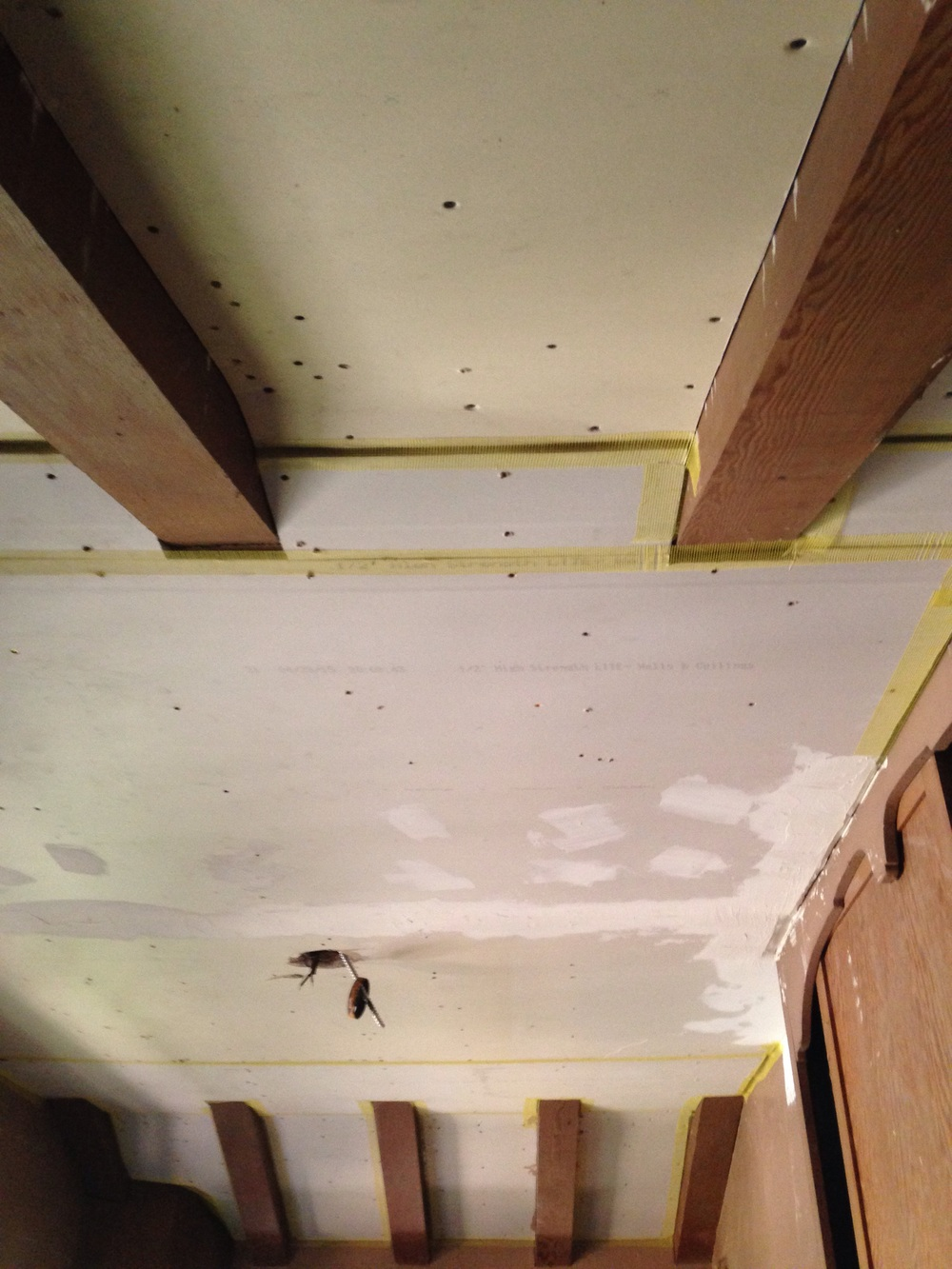 "1/4"" drywall is bendy and used for rounded applications like the curved area between the beams. Pictured is mesh tape and some joint compound"