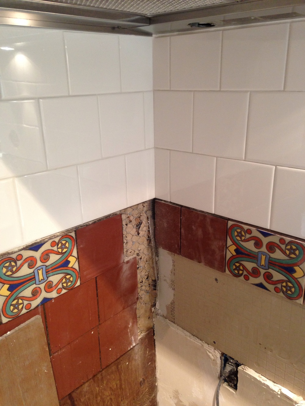 I had to carefully chip out the old mortar bed to reset the corner tiles since I moved the adjacent wall back