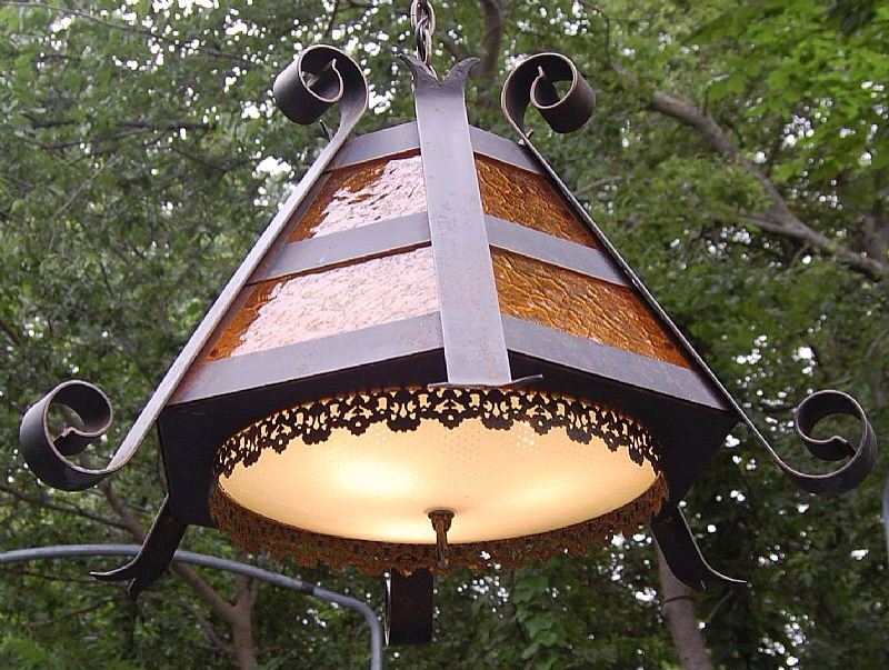 """looking up pics of """"'70s wrought iron light fixture"""" I noticed it was missing the shade https://retrophoria.com/seller/SANTACLARASTUDIO/2-Vintage-Wrought-Iron-and-Amber-Glass-Hanging-Lights/"""