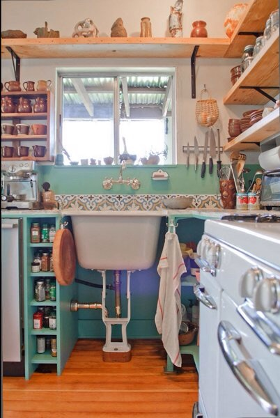 "Hey those look like ""Carthage"" tiles from Tunisia!  The spacer on the bottom of the stand is because the sink is probably 30-33"" tall max while kitchen countertops are 36"""