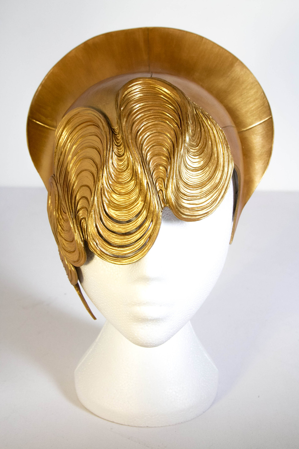 Halo gold leather headpiece.