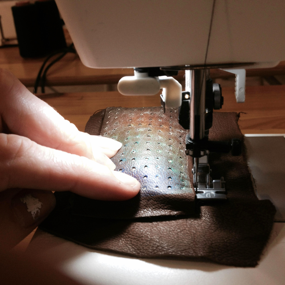sewing the breadboard with a layers of soft padding and dense felt to create the structure