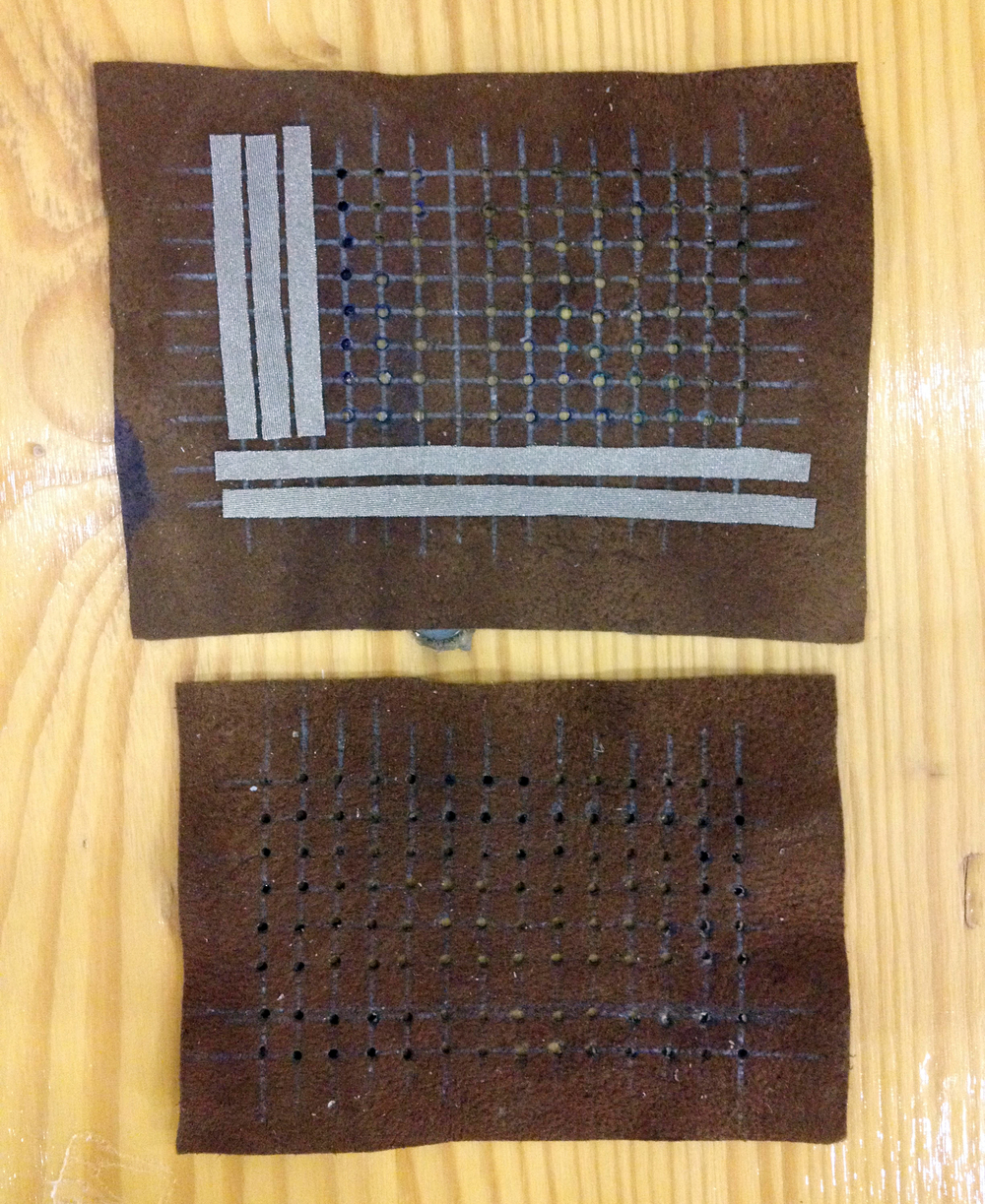 underneath the eTextile breadboard. strips of eeonyx conductive lycra are bonded to hole-punched leather