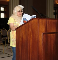 Student reading her work at the 2013 anthology publication celebration