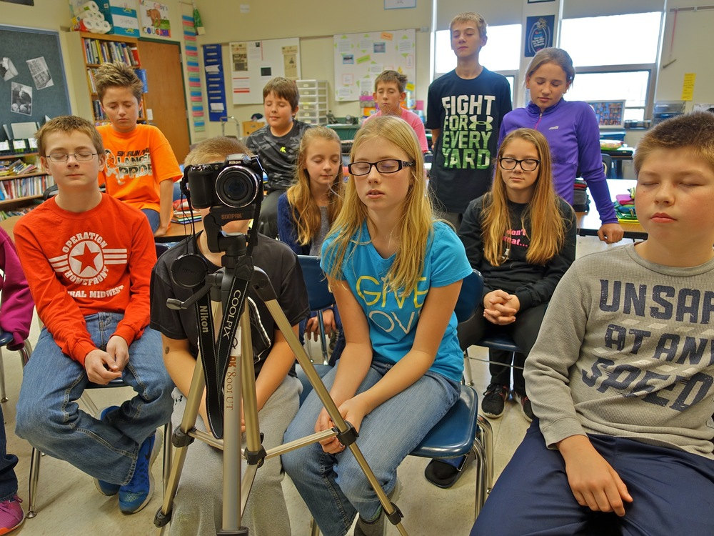 Students listening to the camera, photo by Mike Hazard