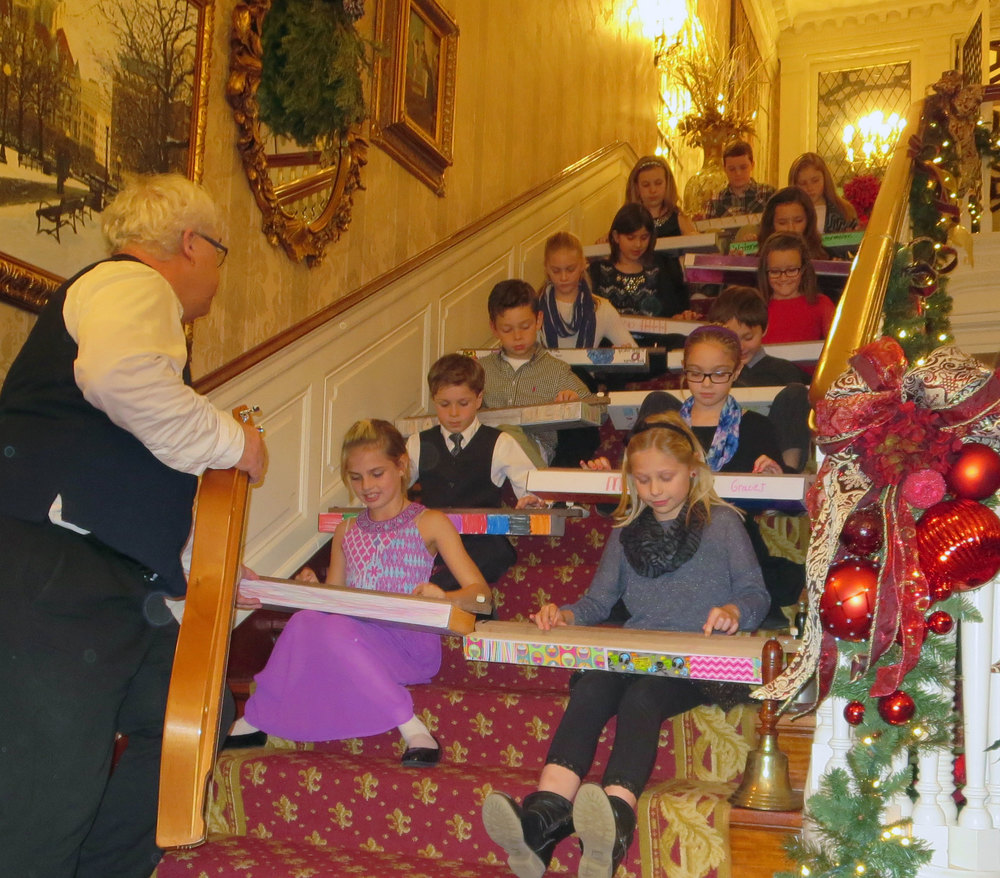 Ross Sutter with Meadowview Elementary students performing a song with their handmade dulcimers
