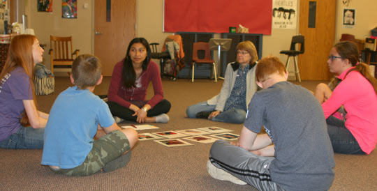 COMPAS teaching artist Saymoukda Vongsay works with students during a writing workshop in Kittson, MN