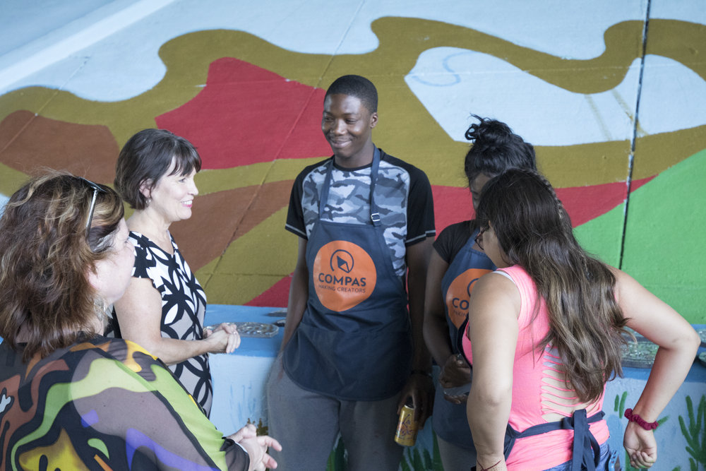ArtsWork apprentices talk with Congresswoman McCollum in front of the mural they are creating. Photo: Noah Linck