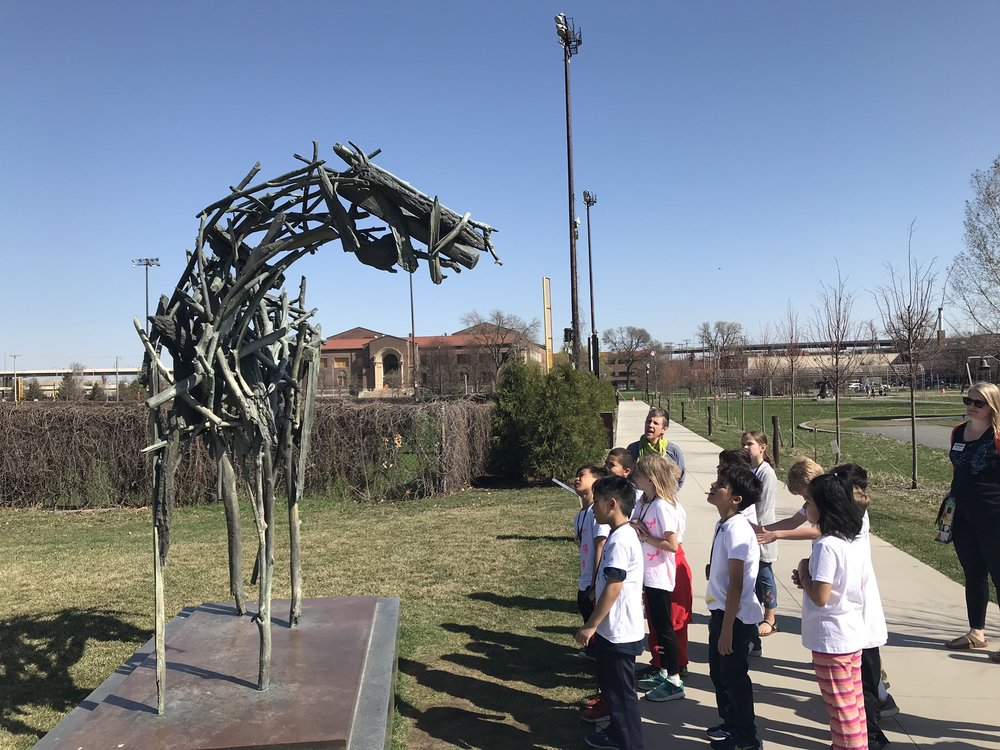 Students from Sibley Elementary at The Walker Art Center observing the Sculpture Garden.