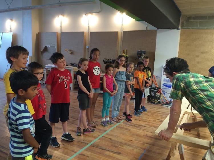 Professor Kearns instructs kids enrolled in the summer program.