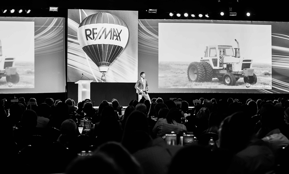 Photo of Seth Mattison engaging with the audience at ReMax event