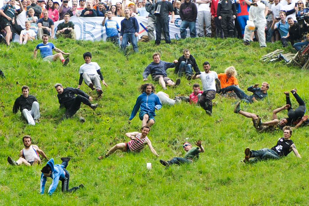 Competitors run after the round of cheese at the Cooper's Hill Cheese Rolling and Wake