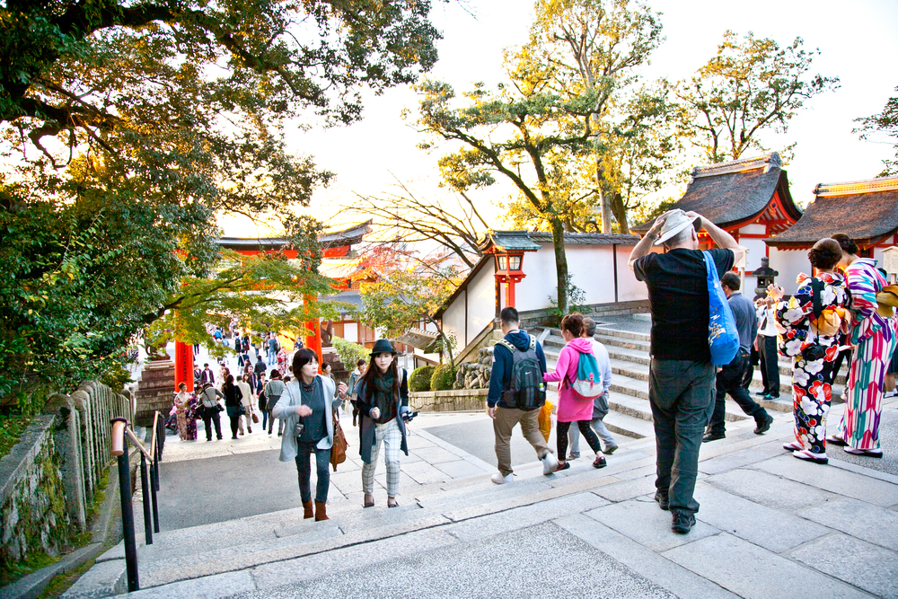 At the back of the shrine is the entrance to the maze of trails through the iconic vermillion torii gates