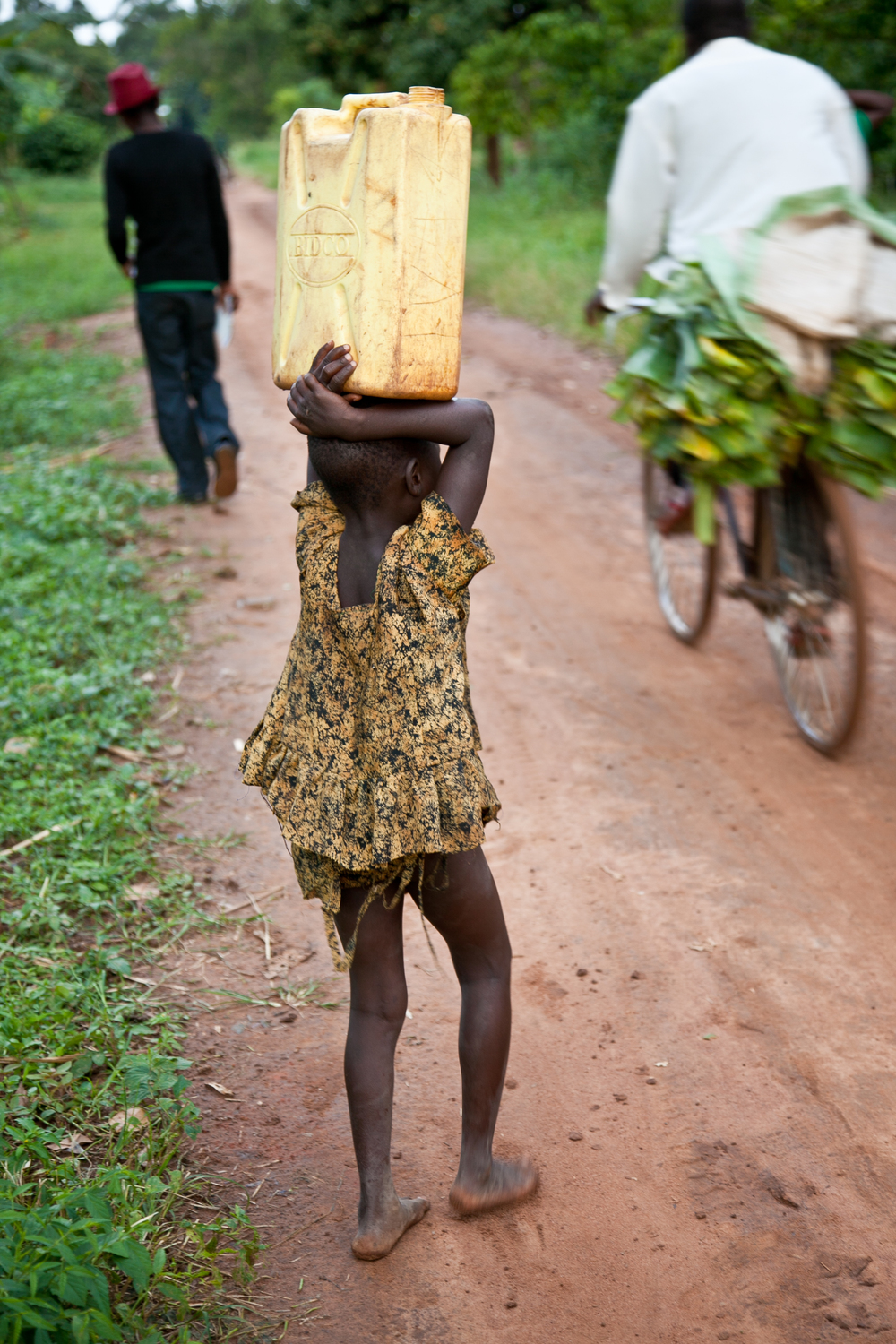 trisa-taro-young-girl-fetching-water-jerry-can-uganda.jpg