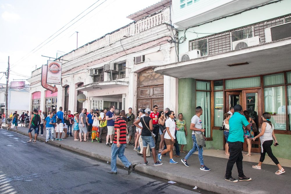 Line outside of a casa de change in Cienfuegos