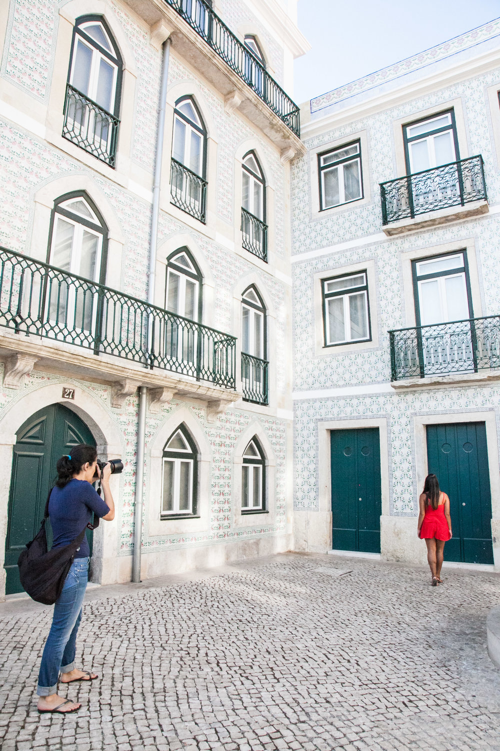 Behind the scenes: our Shoot My Travel photographer Marie capturing me with the beautiful tiles of Lisbon's Alfama district.