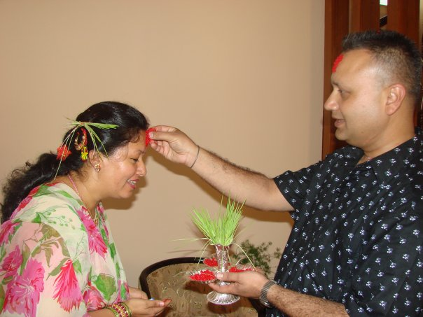 Receiving Tika Jamara on Dashain