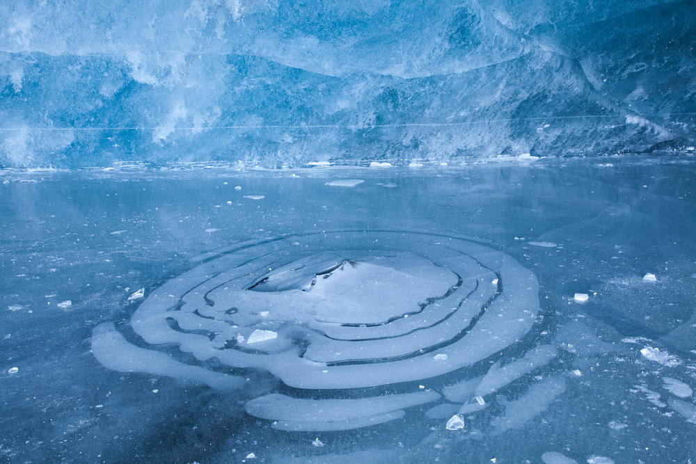 Circular designs inside a glacial ice cave in Jasper National Park, Canada.  Image ©Connor Stefanison