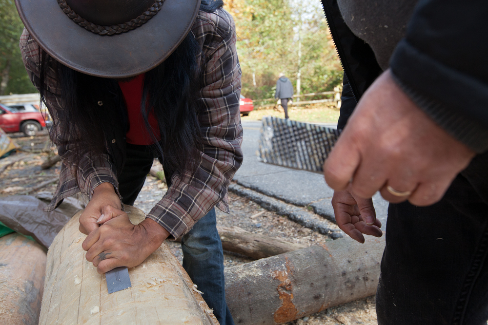A First Nations artist begins creating a totem pole that is planned to be placed over a Kinder Morgan borehole.