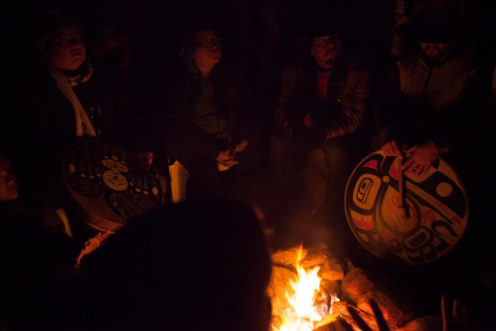 First Nations people gather around the sacred fire, sharing stories and their concerns for the proposed pipeline expansion.