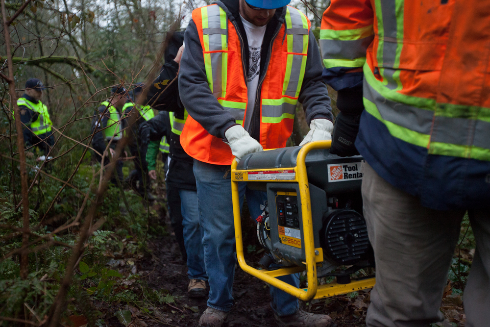 Later that day, Kinder Morgan employees were escorted by police to begin drilling a borehole where the tree sitter was protesting.