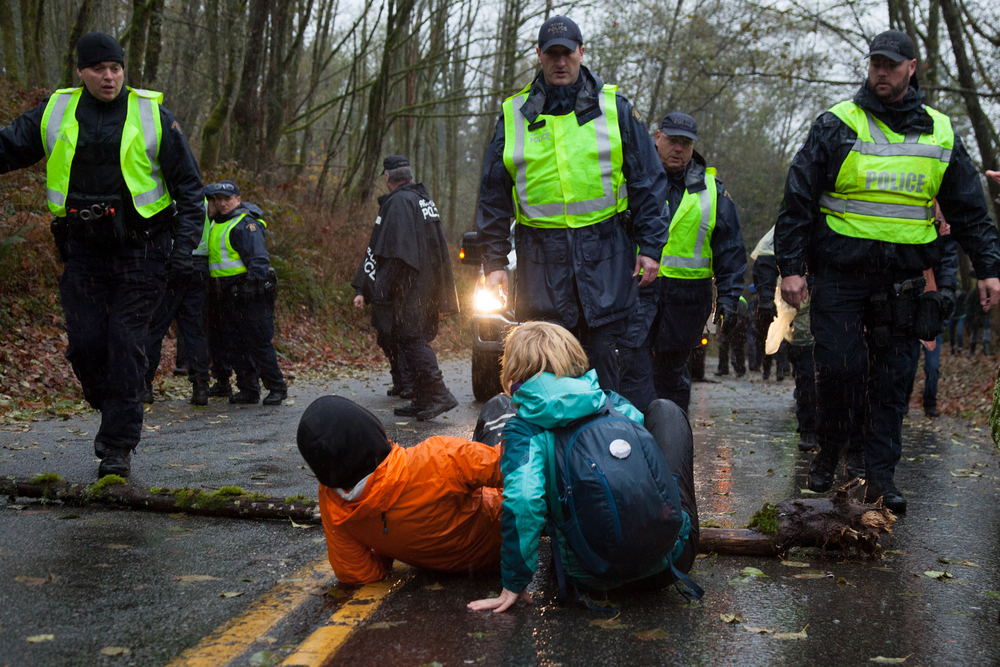 Kinder Morgan eventually made their way up the road, despite the people trying to stop them.