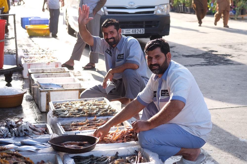 Friendly greetings at the Dubai fish market.