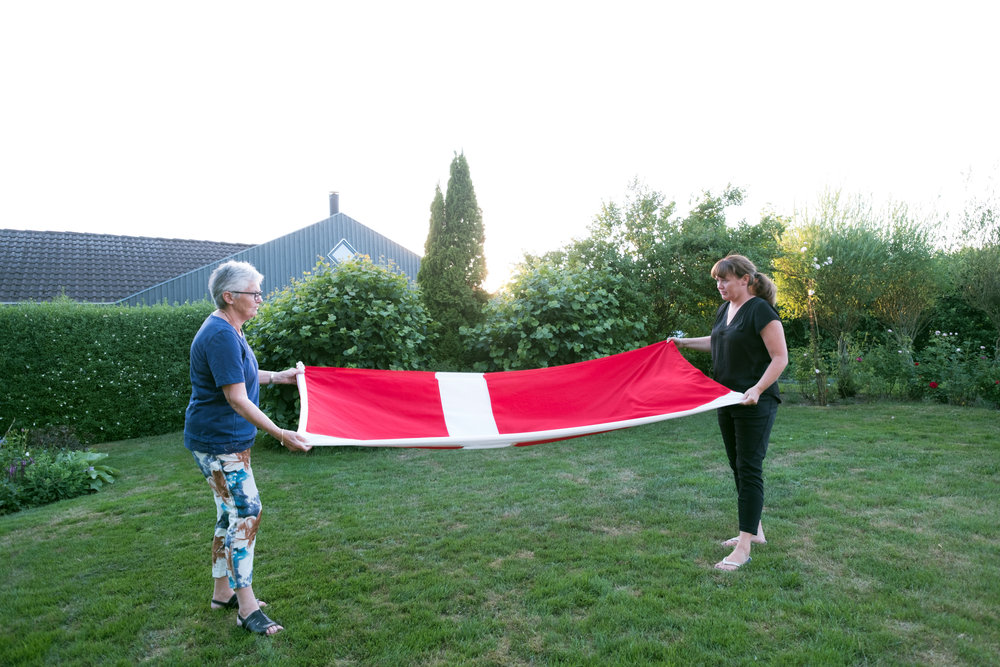 Midsummer nights in Denmark with sunset after 10 pm. Simon's grandmother, Aase, and mother, Karen, take in the flag at the end of the day