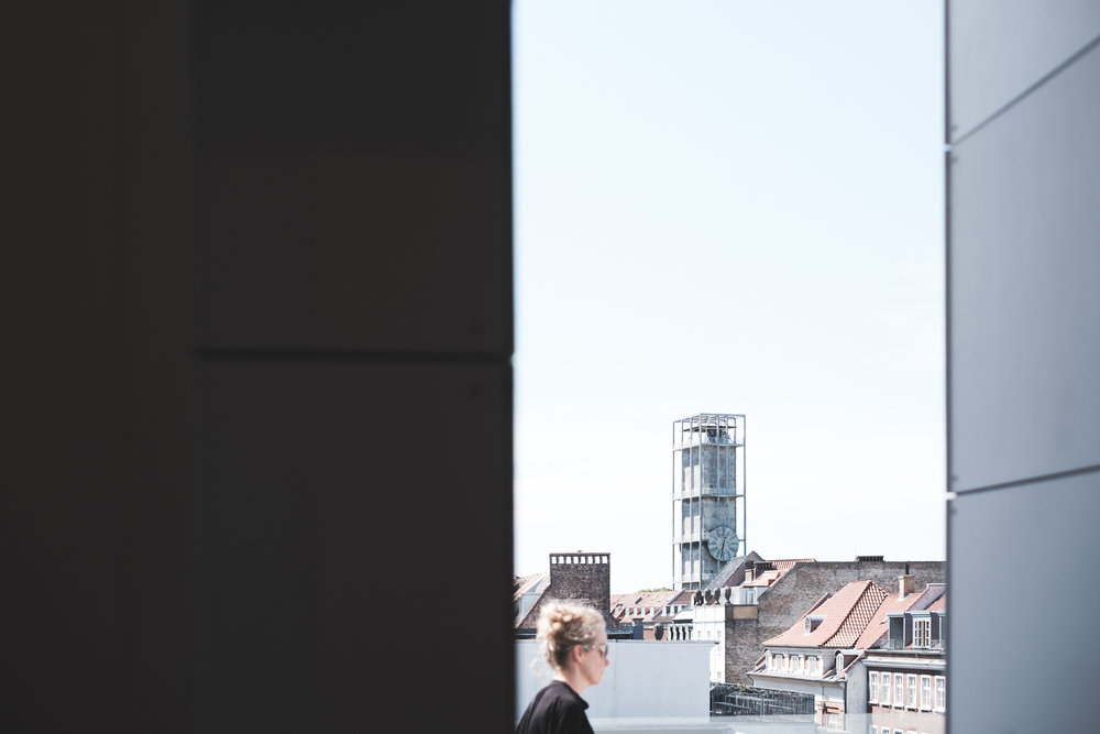 The main department store in Aarhus now has a Rooftop café. In the background, the city hall tower.