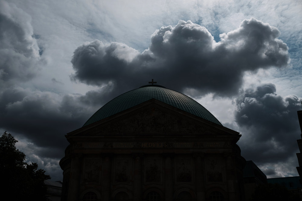 Dark clouds hang over the St. Hedwig's Cathedral, (catholic church) in Berlin. Reading the news from Pennsylvania this week it is easy to understand why.