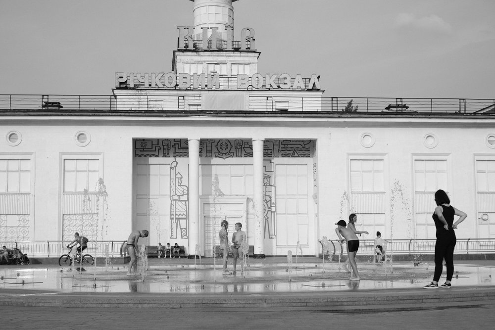 Children are playing in a fountain on a warm day in Kiev Ukraine