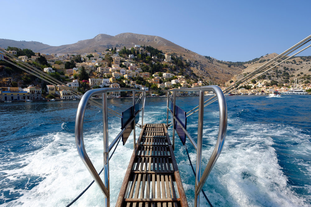 Taking off on The Poseidon boat from Symi in greece