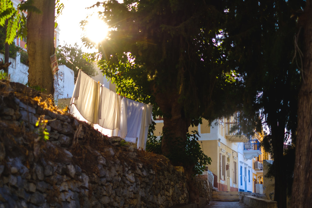 Clothes hung out to dry in a back alley on the island of Symi in Greece