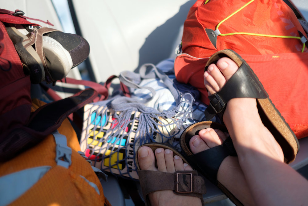 Our travel packs and books on a ferry in Greece