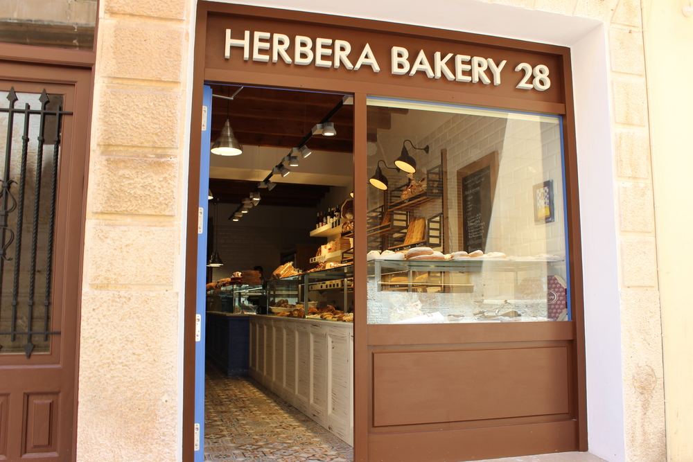 the interior of herbera artisan bakery features tiles and rustic furniture - Rustic Furniture Outlet
