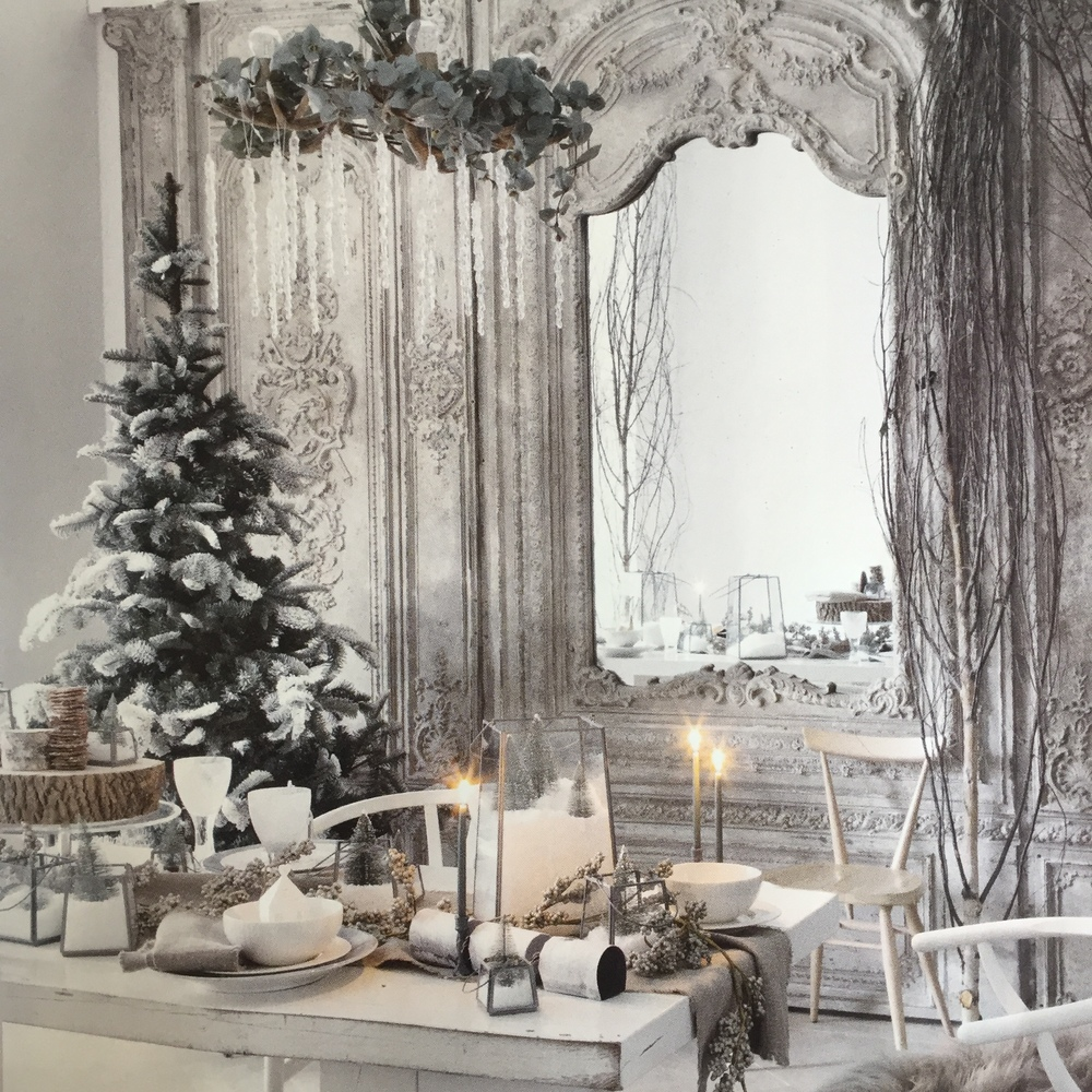 'An icicle chandelier, frosted wine glasses, a scattering of sheepskins plus a pared-back, Scandi-chic table create a dining room scheme fit for  a snow queen' (Living Etc Dec 2015)