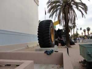 Big tire in front of building